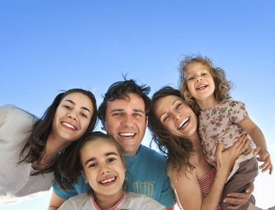 Spokane Valley, WA family smiling about their visit to Grins & Giggles Family Dentistry